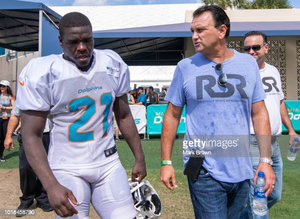 Frank Gore of the Miami Dolphins meets with agent Drew Rosenhaus during Miami Dolphins Training Camp at Baptist Health Training Facility at Nova...