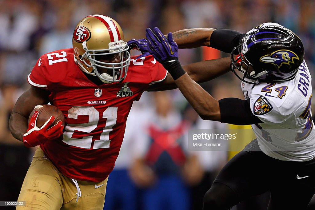 Frank Gore #21 of the San Francisco 49ers breaks a tackle against Corey Graham #24 of the Baltimore Ravens as he runs for a touchdown in the second half during Super Bowl XLVII at the Mercedes-Benz Superdome on February 3, 2013 in New Orleans, Louisiana.