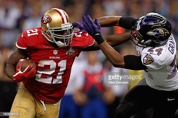 Frank Gore of the San Francisco 49ers breaks a tackle against Corey Graham of the Baltimore Ravens as he runs for a touchdown in the second half...