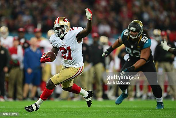 Frank Gore of the San Francisco 49ers breaks free to score a touchdown during the NFL International Series game between San Francisco 49ers and...