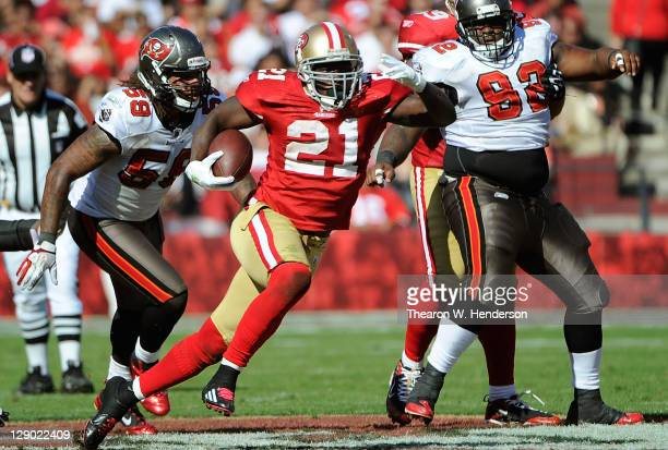 Frank Gore of the San Francisco 49ers carries the ball against the Tampa Bay Buccaneers in the third quarter during an NFL football game at...