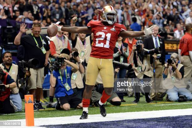 Frank Gore of the San Francisco 49ers celebrates after he scored a 6yard rushing touchdown in the third quarter against the Baltimore Ravens during...