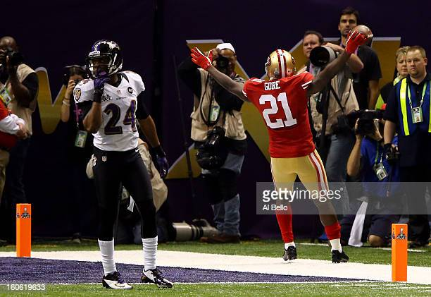 Frank Gore of the San Francisco 49ers celebrates after scoring a touchdown in the third quarter in front of Corey Graham of the Baltimore Ravens...