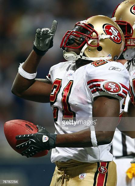 Frank Gore of the San Francisco 49ers celebrates his touchdown in the second quarter against the St Louis Rams at the Edward Jones Dome September 16...