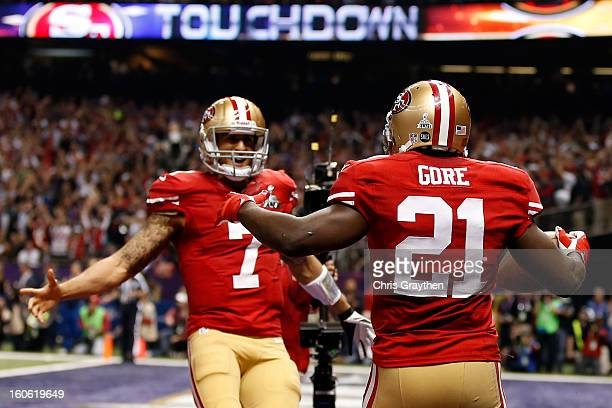 Frank Gore of the San Francisco 49ers celebrates with teammate Colin Kaepernick after scoring a touchdown in the third quarter against the Baltimore...