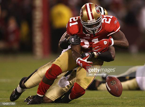 Frank Gore of the San Francisco 49ers fumbles the ball against the New Orleans Saints during an NFL game at Candlestick Park on September 20 2010 in...
