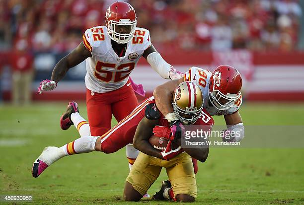 Frank Gore of the San Francisco 49ers gets tackled by Josh Mauga of the Kansas City Chiefs during the fourth quarter at Levi's Stadium on October 5...