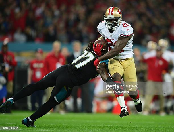 Frank Gore of the San Francisco 49ers goes through Johnathan Cyprien of the Jacksonville Jaguars to score a touchdown during the NFL International...