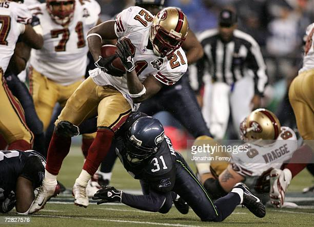 Frank Gore of the San Francisco 49ers is hit by Kelly Herndon of the Seattle Seahawks on December 14 2006 at Qwest Field in Seattle Washington