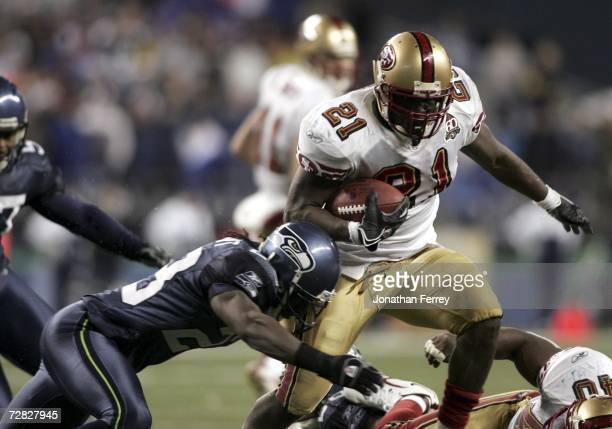 Frank Gore of the San Francisco 49ers is hit by Marcus Trufant of the Seattle Seahawks on December 14 2006 at Qwest Field in Seattle Washington