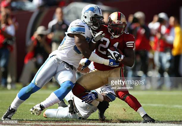 Frank Gore of the San Francisco 49ers runs against Ernie Sims of the Detroit Lions at an NFL game on September 21 2008 at Candlestick Park in San...