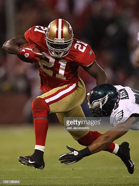 Frank Gore of the San Francisco 49ers runs against Nate Allen of the Philadelphia Eagles during an NFL game at Candlestick Park on October 10 2010 in...