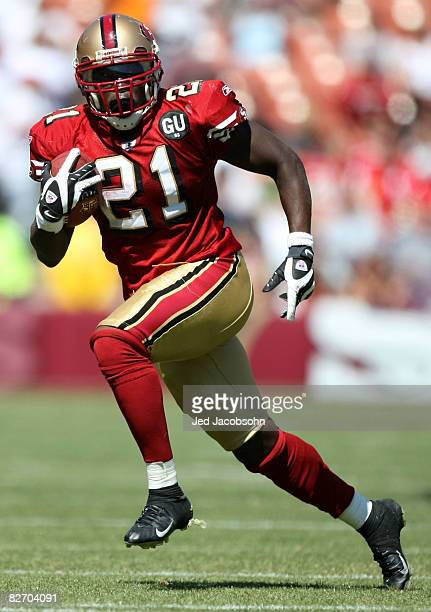 Frank Gore of the San Francisco 49ers runs against the Arizona Cardinals during an NFL game on September 7 2008 at Monster Park in San Francisco...