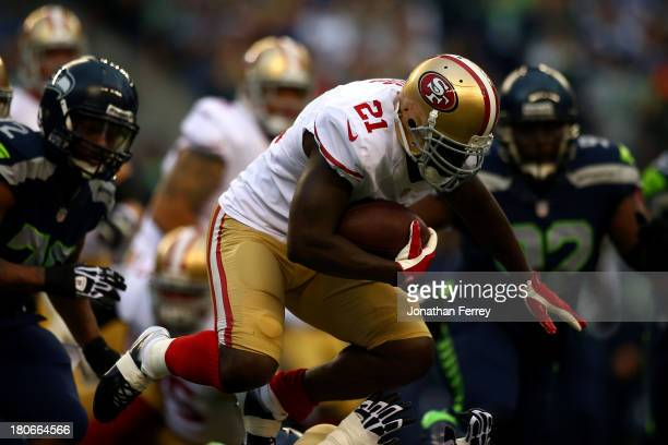 Frank Gore of the San Francisco 49ers runs the ball against the Seattle Seahawks during their game at Qwest Field on September 15 2013 in Seattle...