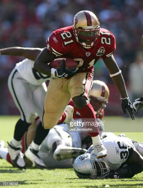 Frank Gore of the San Francisco 49ers runs with the ball against the Oakland Raiders during an NFL game at Monster Park on October 8 2006 in San...