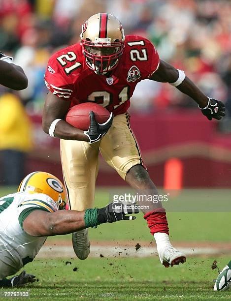 Frank Gore of the San Francisco 49ers runs with the ball against the Green Bay Packers during an NFL game at Monster Park on December 10 2006 in San...