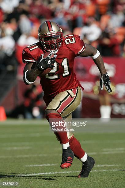 Frank Gore of the San Francisco 49ers runs with the ball during the NFL game against the Tampa Bay Buccaneers on December 23, 2007 at Monster Park in...
