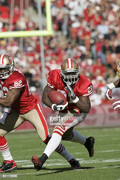 Frank Gore of the San Francisco 49ers runs with the ball during the NFL game against the Washington Redskins on Bill Walsh Field at Candlestick Park...