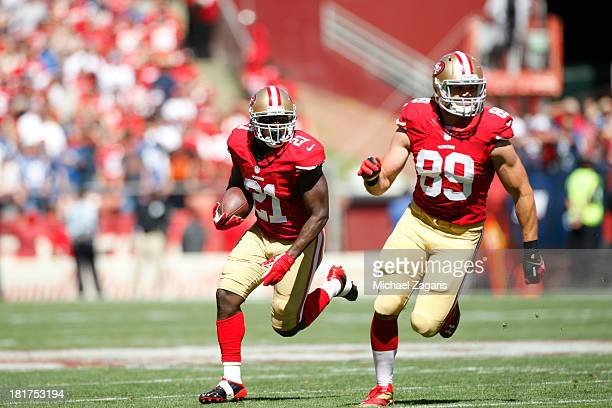 Frank Gore of the San Francisco 49ers rushes behind Vance McDonald during the game against the Indianapolis Colts at Candlestick Park on September 22...