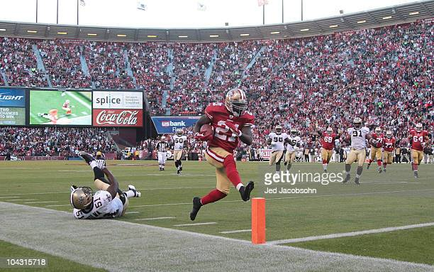 Frank Gore of the San Francisco 49ers scores a touchdown against the New Orleans Saints during an NFL game at Candlestick Park on September 20 2010...