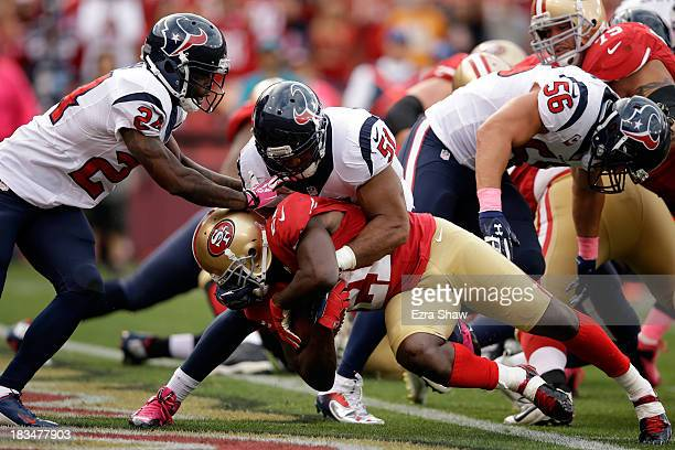 Frank Gore of the San Francisco 49ers scores a touchdown in the first quarter against the Houston Texans during their game at Candlestick Park on...