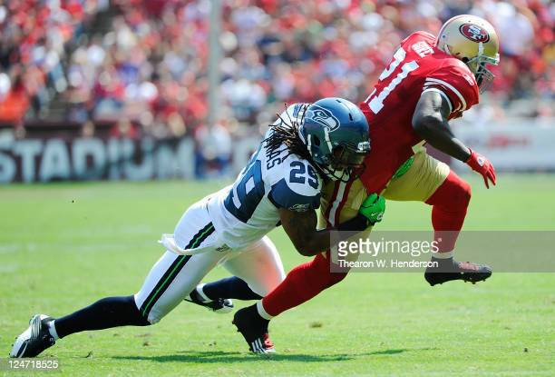 Frank Gore of the San Francisco 49ers tries to run out of the grip of Earl Thomas of the Seattle Seahawks in the second quarter during the...
