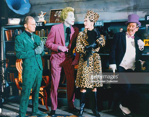 Frank Gorshin , US actor and comedian, Cesar Romero , Lee Meriwether, US actress, and Burgess Meredith , US actor, all in costume, in a publicity...