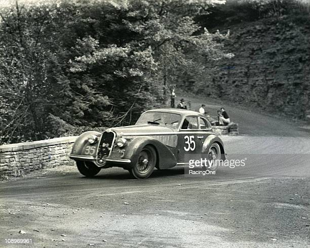 Frank Griswald at the wheel of his Alfa Romeo 8C 2900B on his way to winning the Watkins Glen Grand Prix in the city streets This was the first ever...