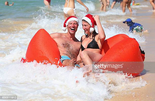 Frank Groot and Josephine Groot from Amsterdam The Netherlands play on their inflatable couch at Bondi Beach on December 25 2016 in Sydney Australia...