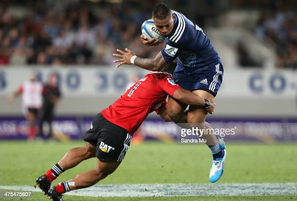 Frank Halai of the Blues is tackled during the round three Super Rugby match between the Auckland Blues and the Christchurch Crusaders at Eden Park...