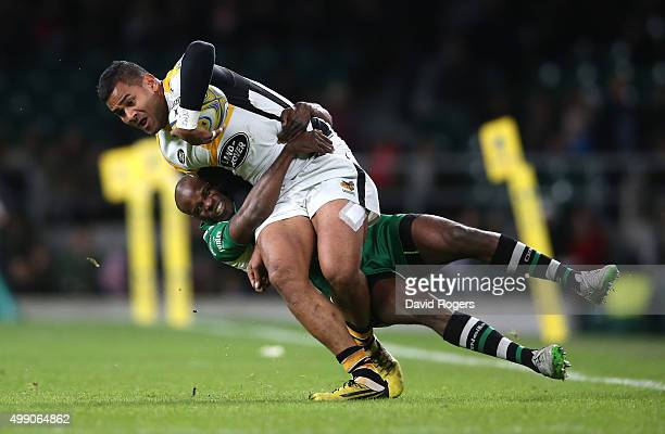 Frank Halai of Wasps is tackled by Topsy Ojo during the Aviva Premiership match between London Irish and Wasps at Twickenham Stadium on November 28...
