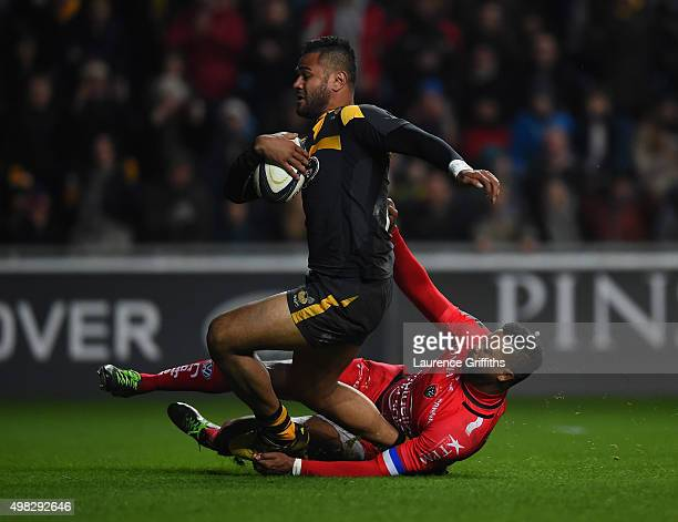 Frank Halai of Wasps scores a try under pressure from Delon Armitage of Toulon during the European Rugby Champions Cup match between Wasps and Toulon...