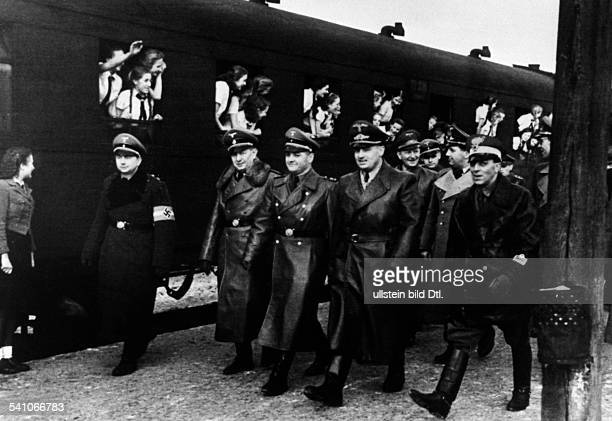 Frank, Hans *-+Nazi Germany's chief jurist and Governor-General of occupied Polandwelcoming girls from Brandenburg on their passage to Krynica with...