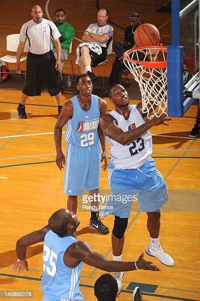 Frank Hassell of the Canton Charge goes to the basket past James Delroy of the Tulsa 66ers and Anthony Mason, Jr. #29 of the Sioux Falls Skyforce on...