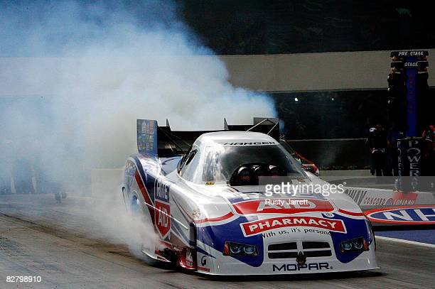 Frank Hawley driver of the Rite Aid funny car does his burn out during qualifying for the NHRA Carolinas Nationals at the Zmax Dragway on September...