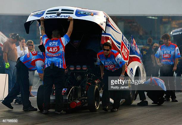 Frank Hawley driver of the Rite Aid funny car has adjustments made before his qualifying run during the NHRA Carolinas Nationals at the Zmax Dragway...