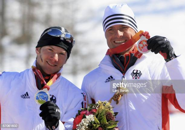 Frank Hoefle and guide Johannes Wachlin of Germany celebrate winning the silver medal in the Men's 5KM Visually Impaired Cross Country during day two...