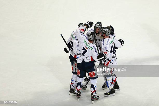 Frank Hoerdler of Berlin celebrates his team's second goal with team mates during the DEL match between Adler Mannheim and Eisbaeren Berlin at SAP...