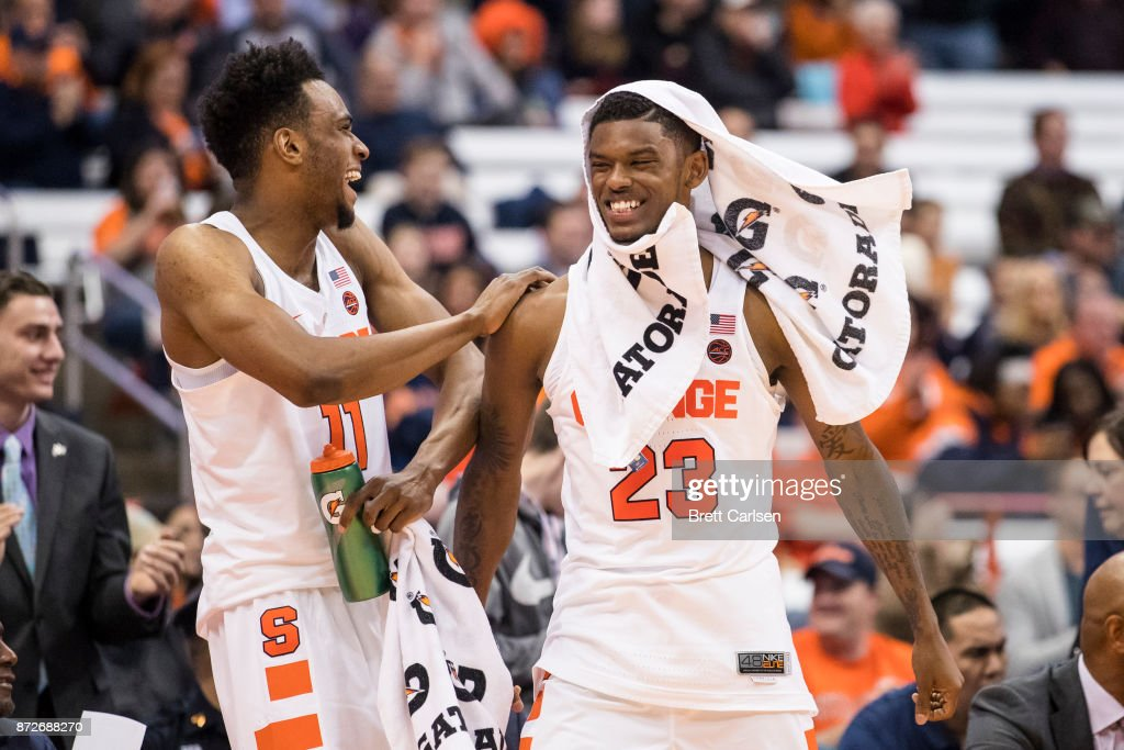 Frank Howard #23 and Oshae Brissett #11 of the Syracuse Orange celebrates a score by Patrick Herlihy #5 in the final minutes against the Cornell Big Red at the Carrier Dome on November 10, 2017 in Syracuse, New York. Syracuse defeats Cornell 77-45.