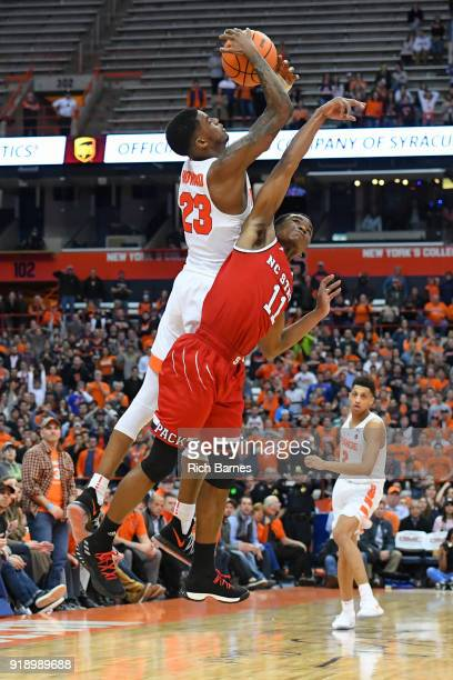 Frank Howard of the Syracuse Orange and Markell Johnson of the North Carolina State Wolfpack battle for control of the ball during the second half at...
