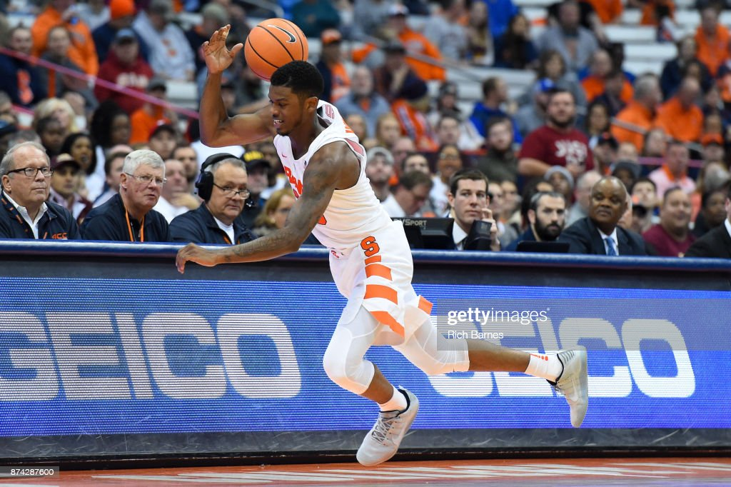 Frank Howard #23 of the Syracuse Orange attempts to keep a loose ball from going out of bounds against the Iona Gaels during the second half at the Carrier Dome on November 14, 2017 in Syracuse, New York. Syracuse defeated Iona 71-62.