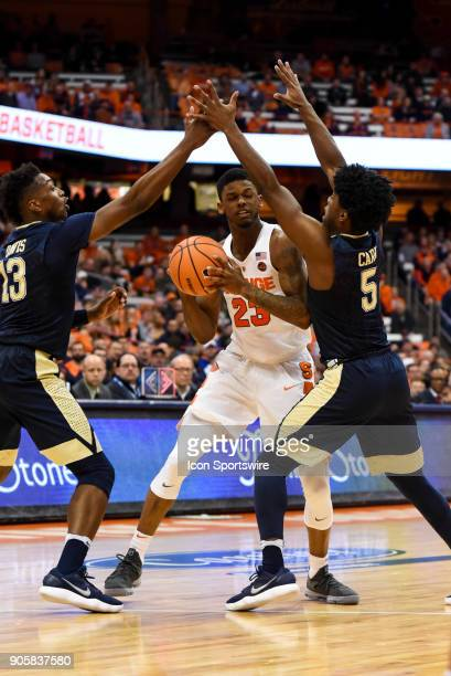 Frank Howard of the Syracuse Orange drives to the basket between Marcus Carr and Khameron Davis of the Pittsburgh Panthers during the second half of...
