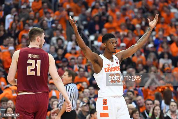 Frank Howard of the Syracuse Orange gestures to the crowd as Nik Popovic of the Boston College Eagles looks on during the first half at the Carrier...
