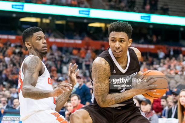 Frank Howard of the Syracuse Orange participates in a full court press as Jaylen Adams of the St Bonaventure Bonnies receives the inbound pass during...