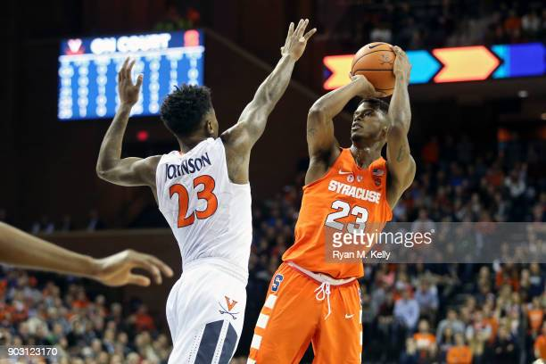 Frank Howard of the Syracuse Orange shoots over Nigel Johnson of the Virginia Cavaliers in the first half during a game at John Paul Jones Arena on...