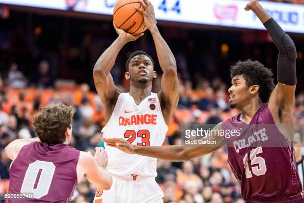 Frank Howard of the Syracuse Orange shoots the ball between Sean O'Brien and Jordan Swopshire of the Colgate Raiders during the second half at the...