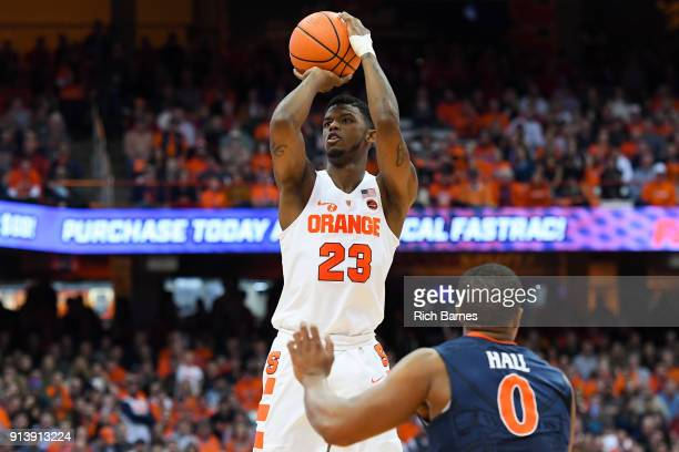 Frank Howard of the Syracuse Orange shoots the ball over Devon Hall of the Virginia Cavaliers during the second half at the Carrier Dome on February...