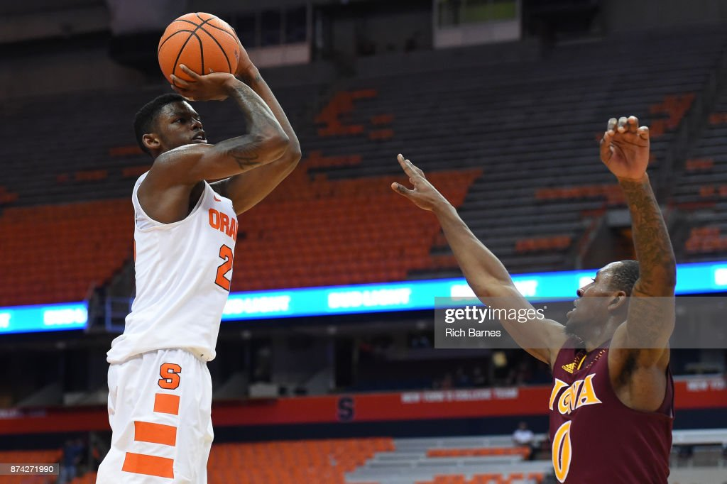 Frank Howard #23 of the Syracuse Orange shoots the ball over Rickey McGill #0 of the Iona Gaels during the first half at the Carrier Dome on November 14, 2017 in Syracuse, New York.