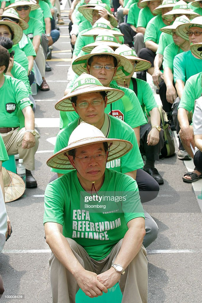 Frank Hsieh, Taiwan's former premier, leads supporters at a sit-in protest in Taipei, Taiwan, on Thursday, May 20, 2010. President Ma Ying-jeou has pushed for the trade agreement with China to prevent Taiwan from being 'marginalized' after a Chinese accord with the 10-member Association of Southeast Asian Nations took effect this year. The proposal sparked opposition demonstrations amid concern China may boost its influence over Taiwan. Photographer: Maurice Tsai/Bloomberg via Getty Images