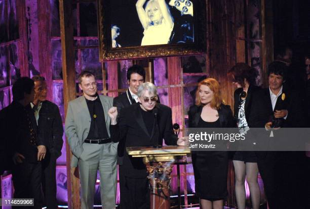 Frank Infante Nigel Harrison Gary Valentine Jimmy Destri Chris Stein Debbie Harry and Clem Burke of Blondie inductees with presenter Shirley Manson